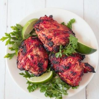 Chicken thighs from a Tandoori Chicken recipe on a platter