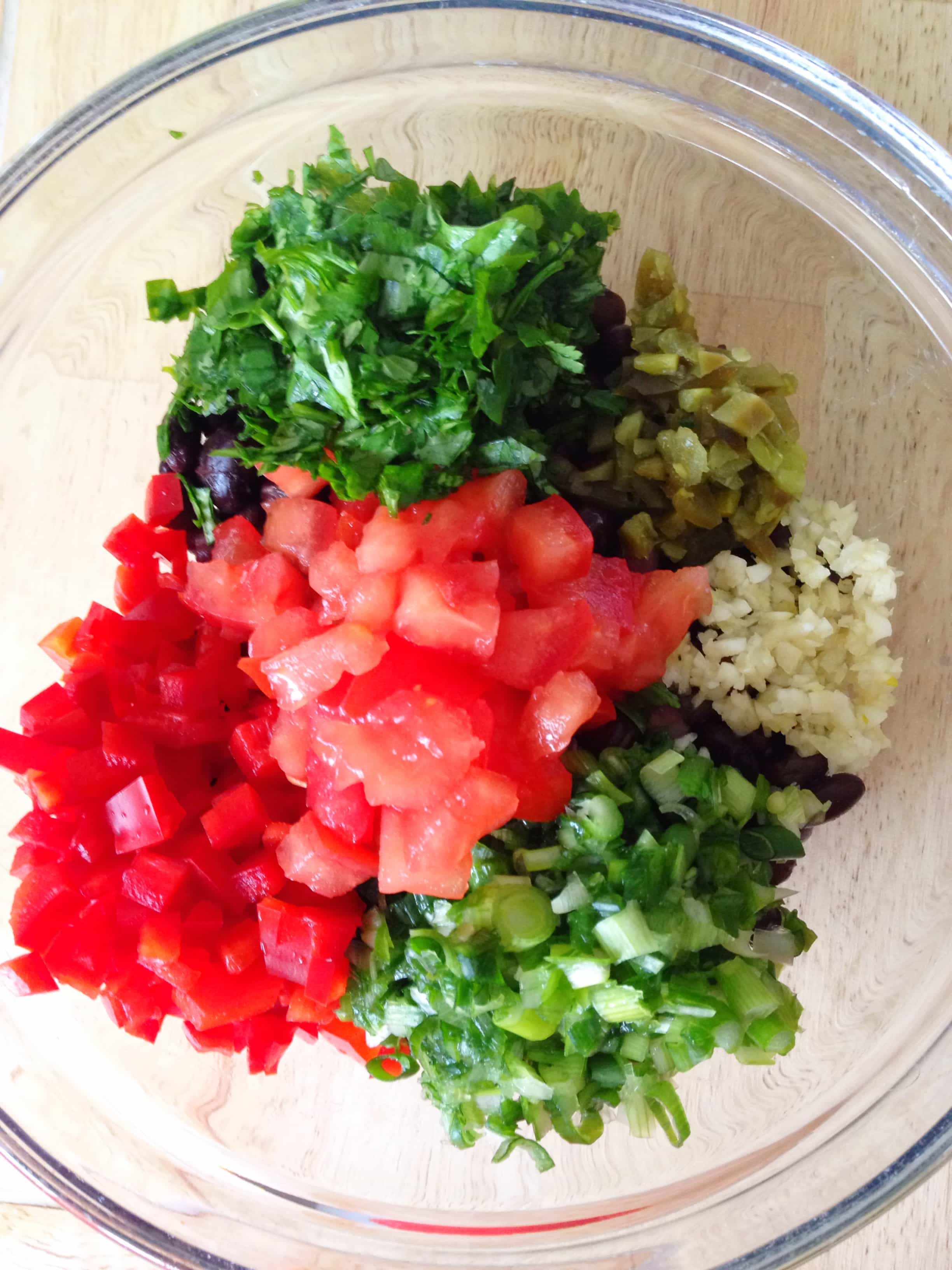 Fresh ingredients all chopped up in a bowl for the black bean salsa