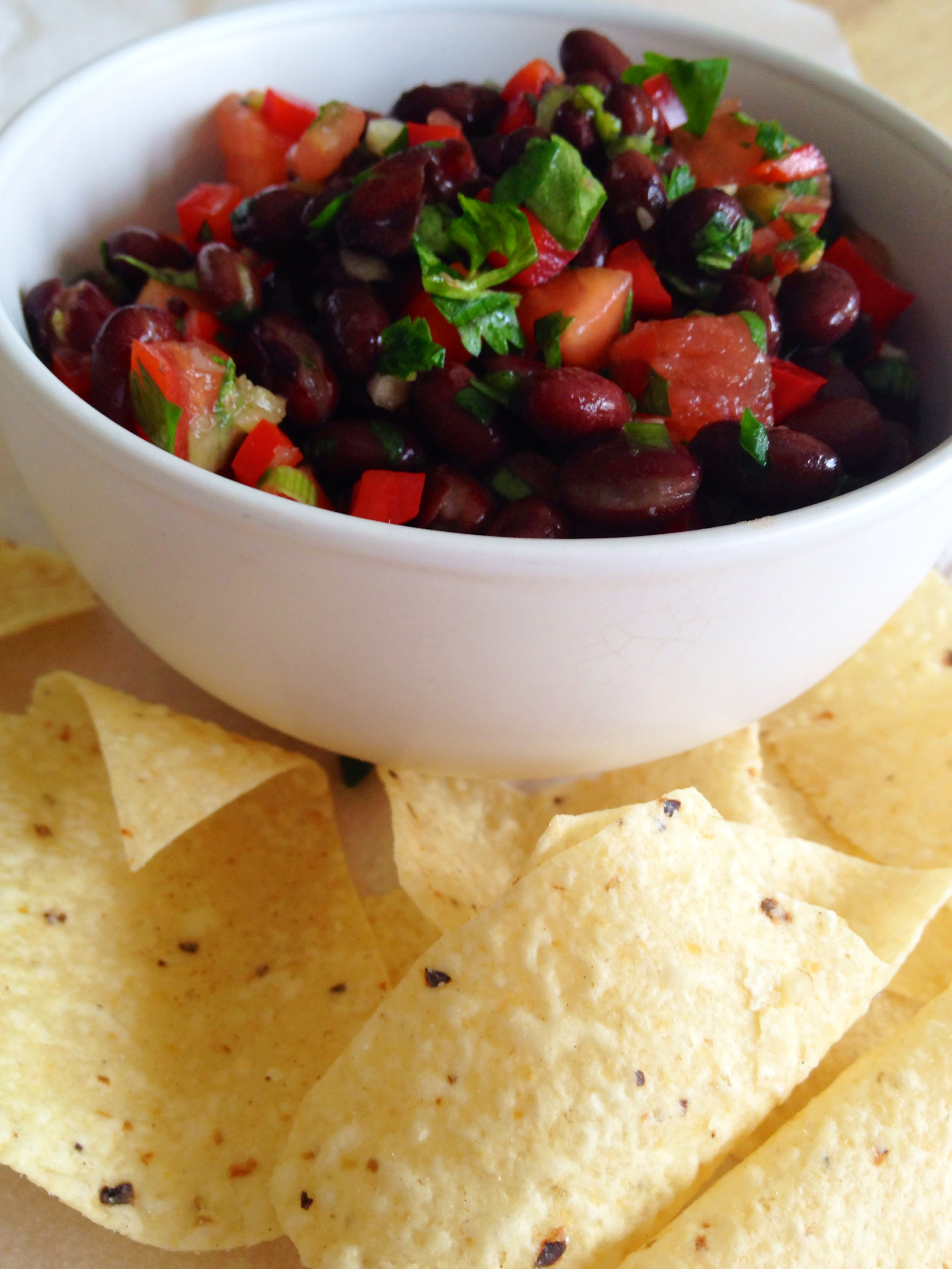 Black Bean Salsa in a white bowl with corn chips