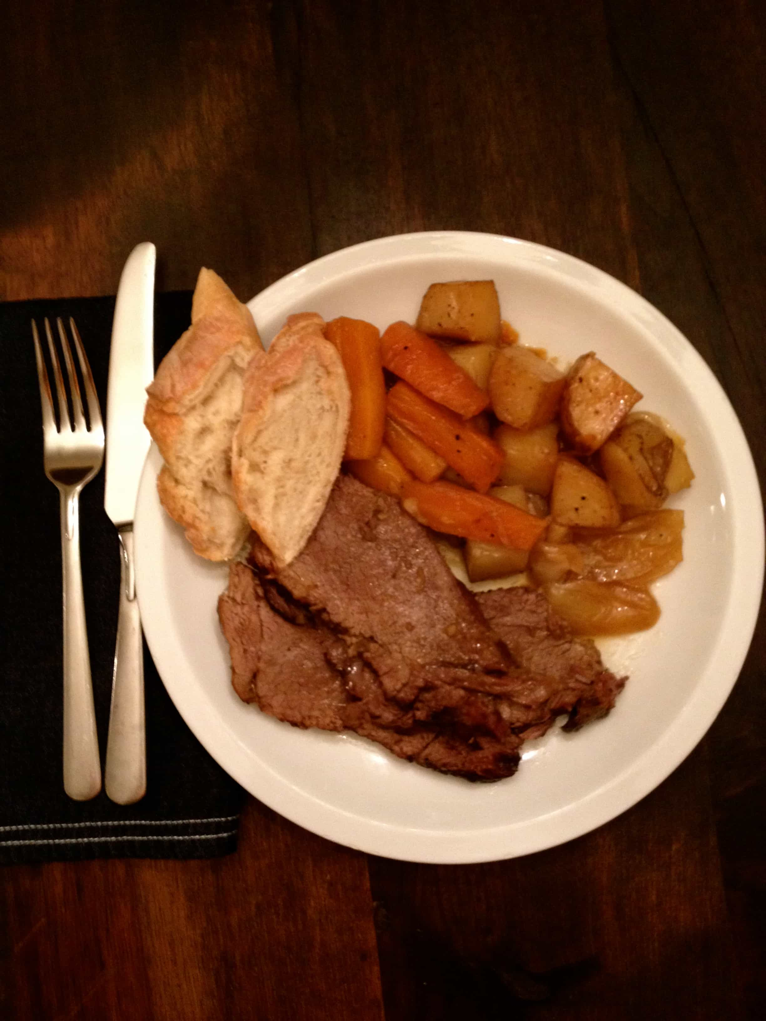 Photo of The Easiest And Best Pot Roast Ever cooked on plate with carrots, potatoes, and french bread