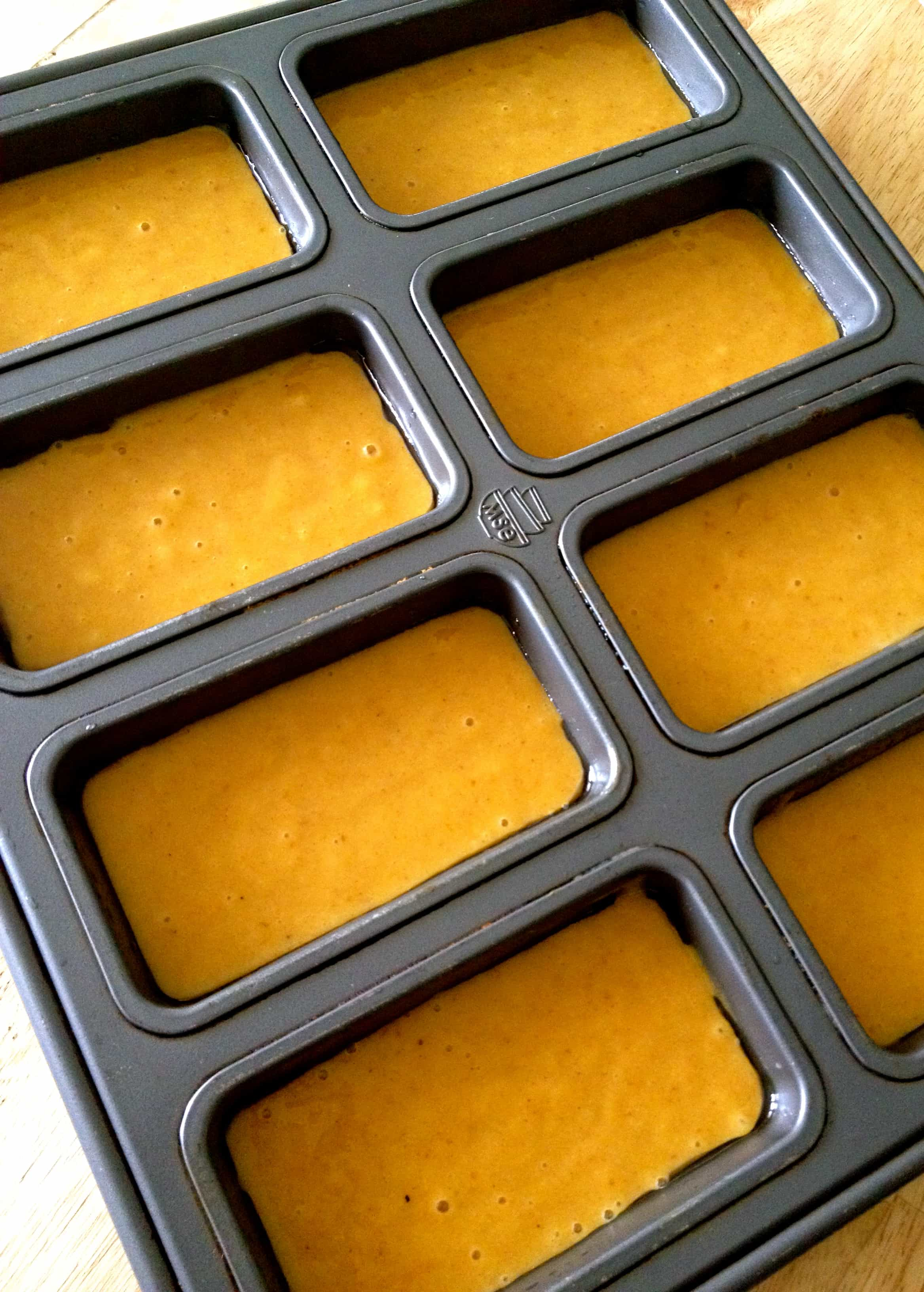 Pumpkin batter in a mini bread loaf pan ready for the oven