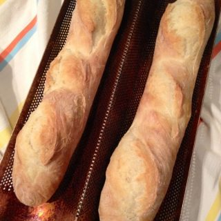 Loaves of french bread in a dual bread pan