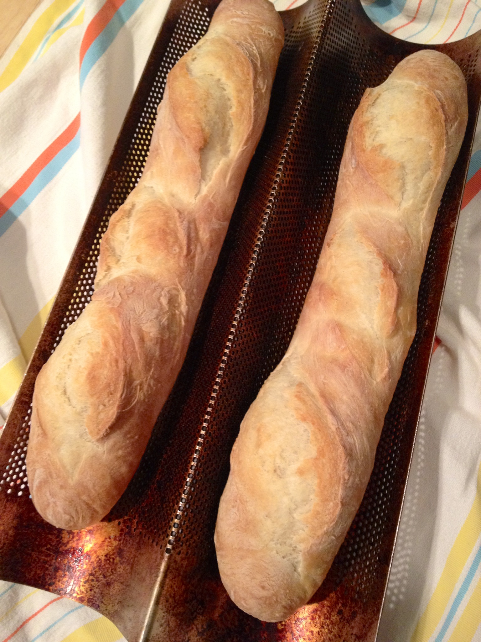 Cooked french bread baguettes fresh and hot right out of the oven.
