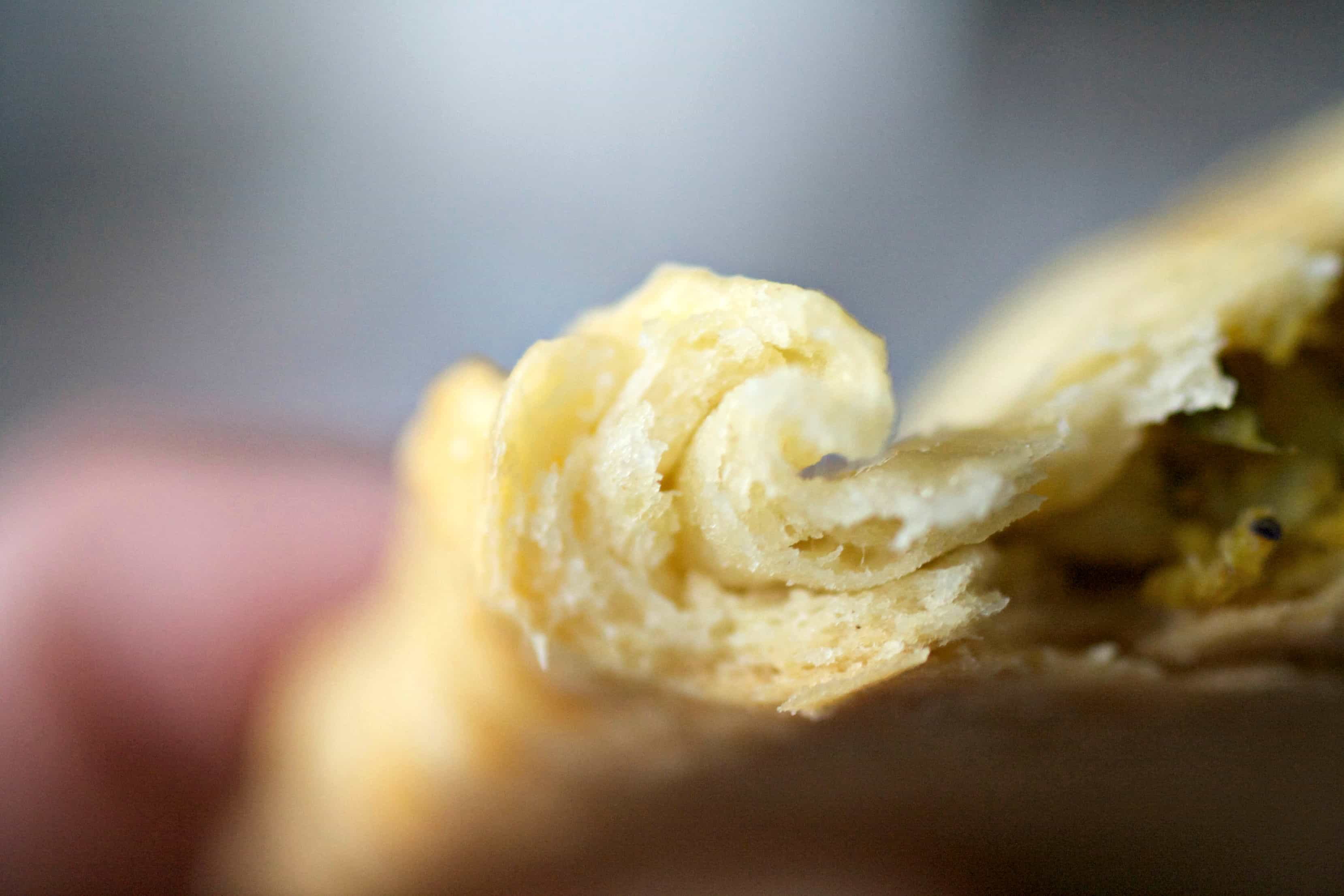 The inside of a flaky cooked pastry dough crust