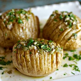 Three Chimichurri Hasselback Potatoes on a plate