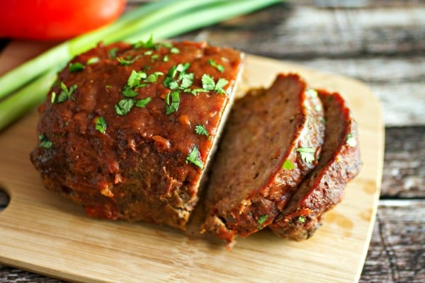 Smoked Meatloaf sliced on a wooden cutting board