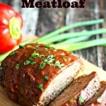 Smoked Meatloaf on a cutting board with red peppers and green onions