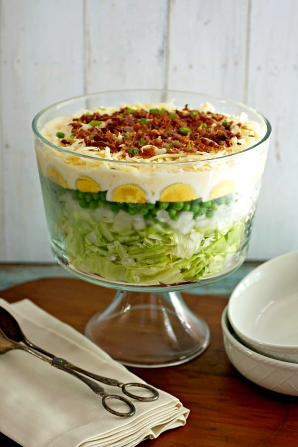 photo of easy 7 layer salad recipe in trifle bowl