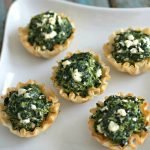 Plate of mini Spanakopitas greek spinach pies