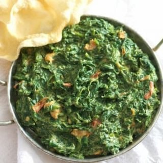 Easy Indian creamed spinach in a pan with bread