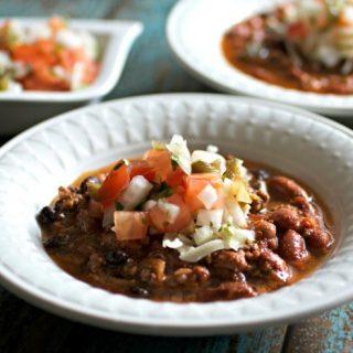 Beef and Chorizo Chili in a bowl with pico de gallo salsa