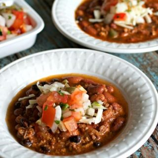 Bowls of Beef and Chorizo Chili with pico de gallo on the side.