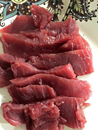 Raw sliced tuna on a plate