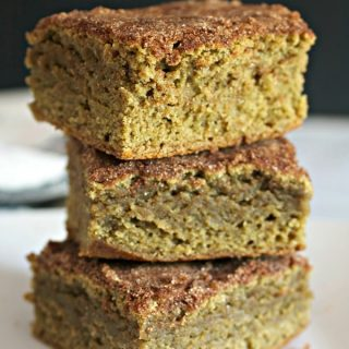 3 Matcha Snickerdoodle Blondies on a plate stacked on top of each other