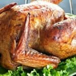 DOuble rum smoked turkey recipe on a platter with lettuce