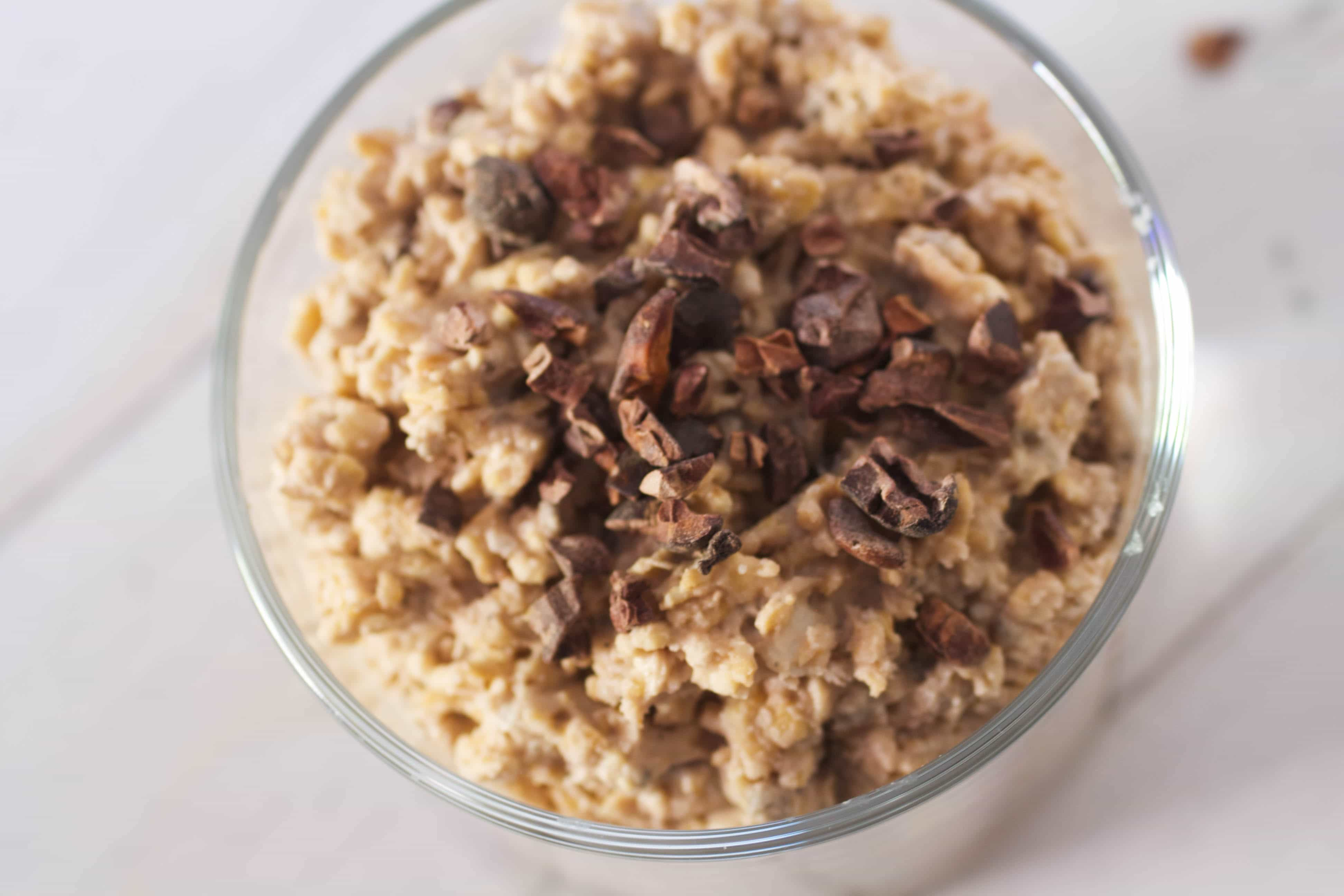 Healthy breakfast oats with cacao nibs sprinkled on top.