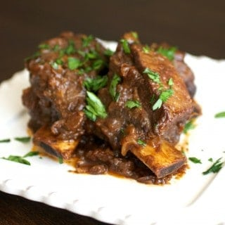 Braised beef short ribs on a dinner plate