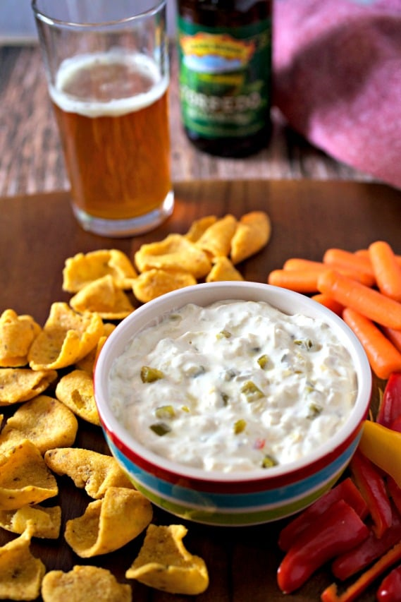 Copycat Trader Joe's Jalapeño artichoke Dip on a counter with a beer in the background