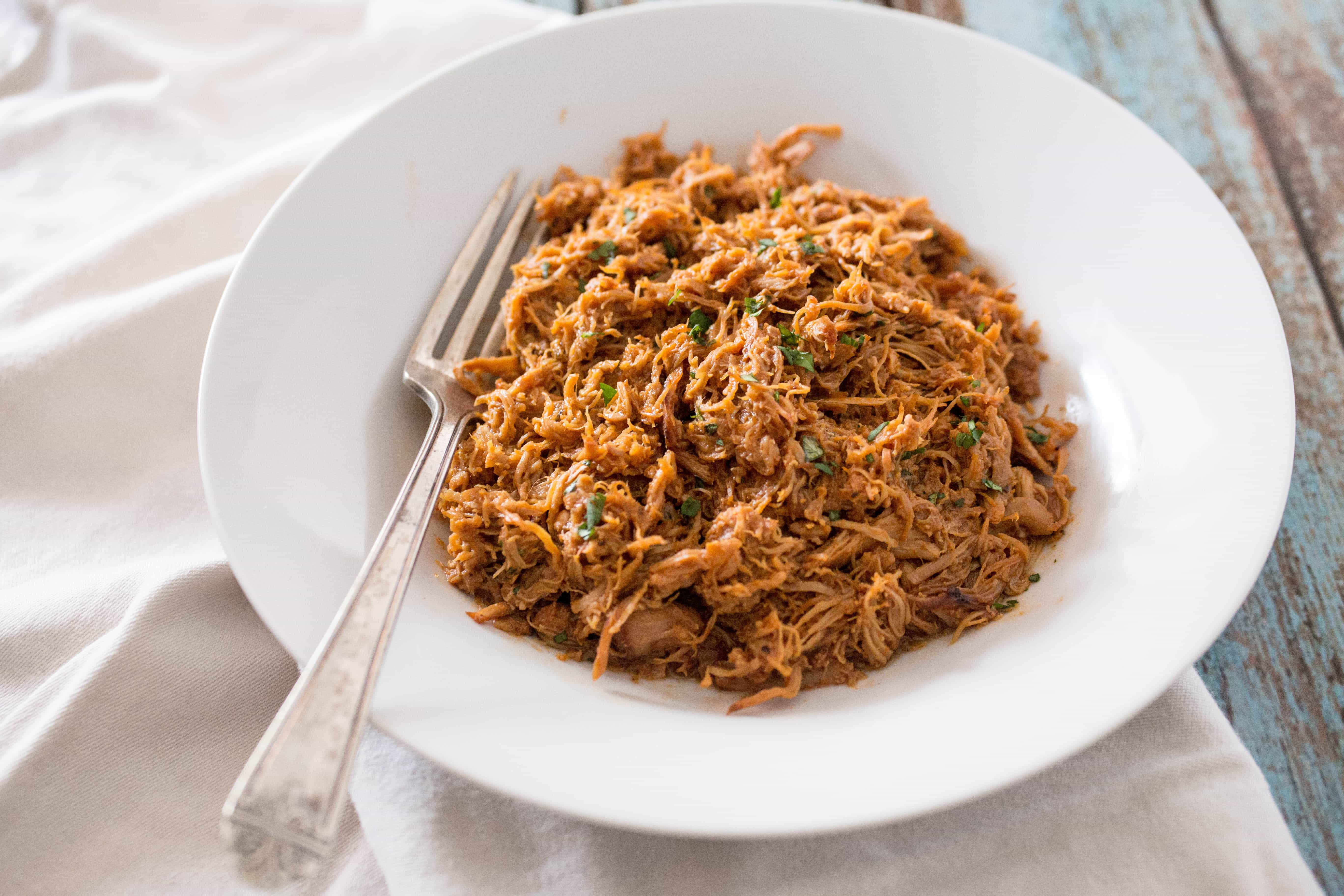 Plate of Instant Pot Shredded BBQ Chicken with a fork ready to serve