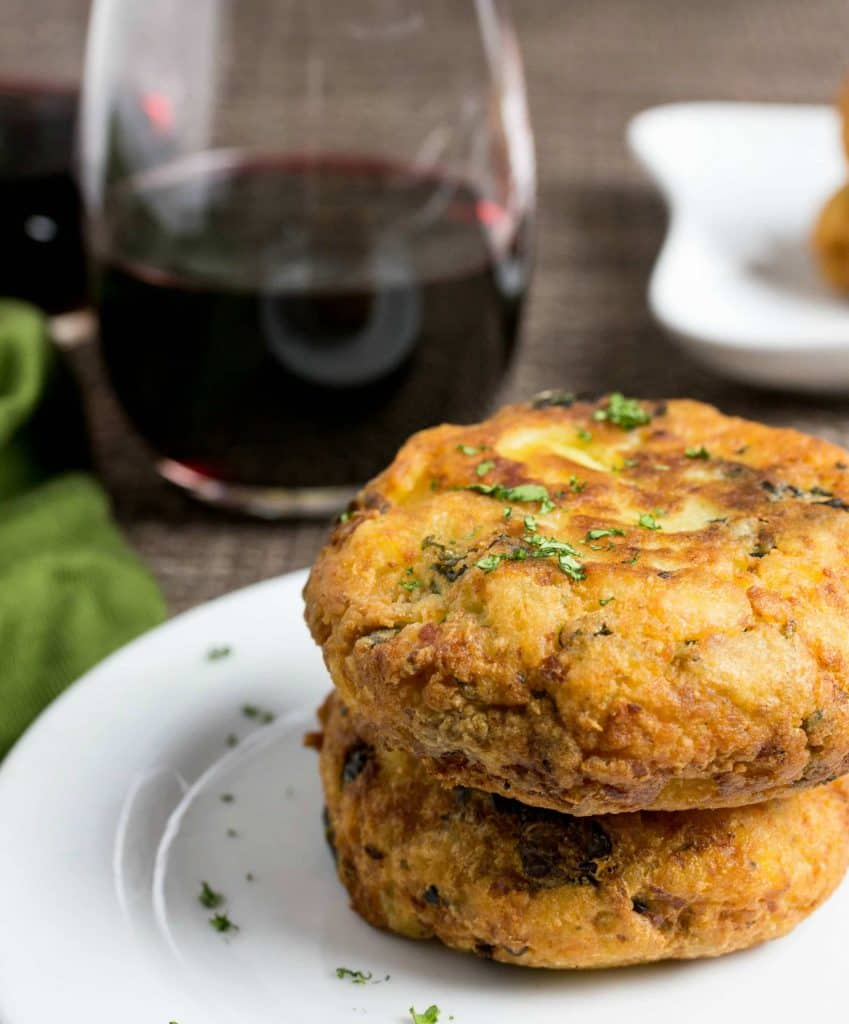 Mashed Potato Pancakes on a plate with a glass of red wine