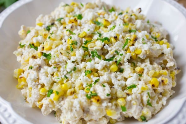 Cold potato Salad in a bowl with charred corn and fresh chopped cilantro.