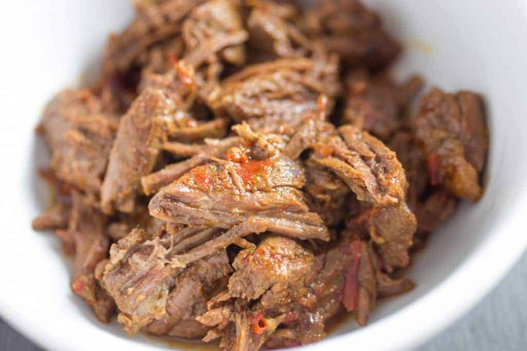 Cooked Mexican shredded Beef with salsa in a bowl.