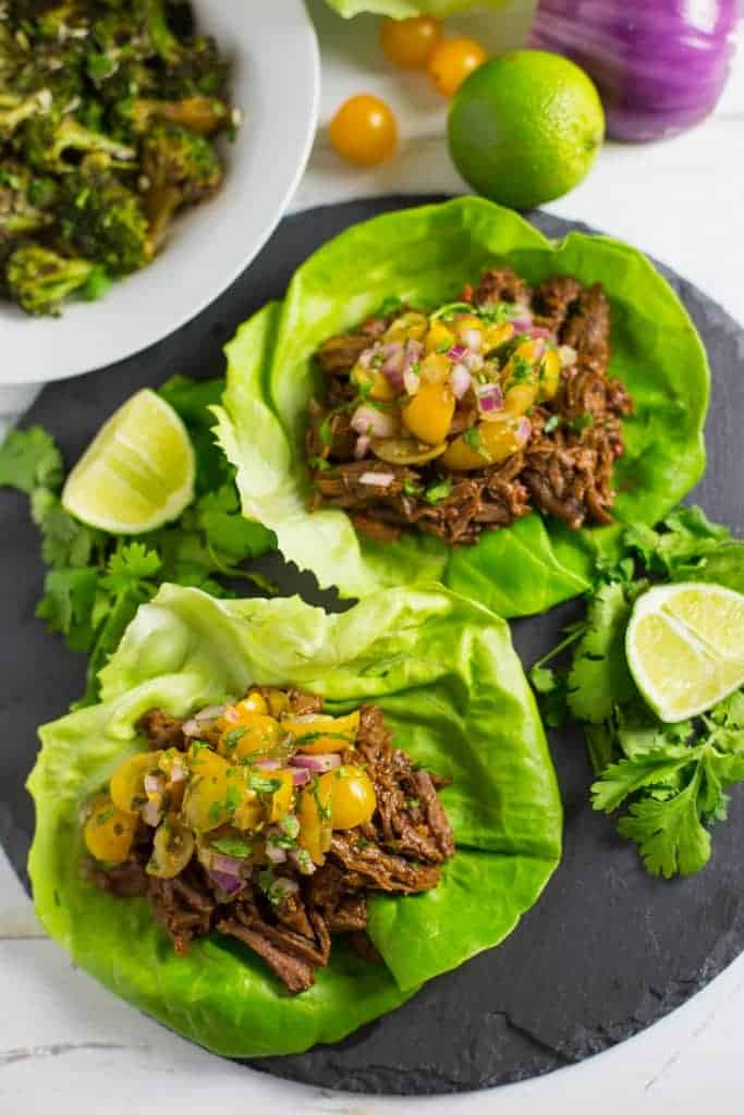 Instant Pot Shredded Beef Tacos wrapped in butter lettuce leaves and topped with salsa