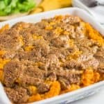 Photo of sweet potato casserole in a square baking pan