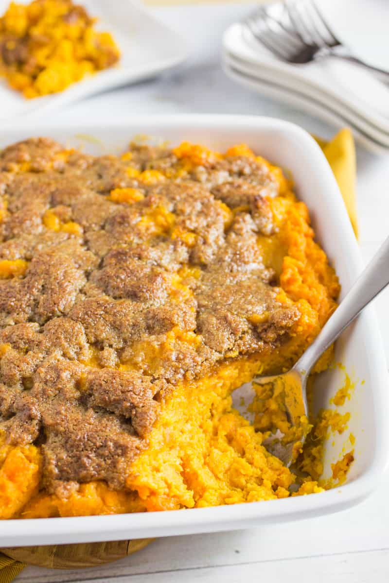 Easy Sweet Potato Casserole Recipe without nuts with spoon in the dish