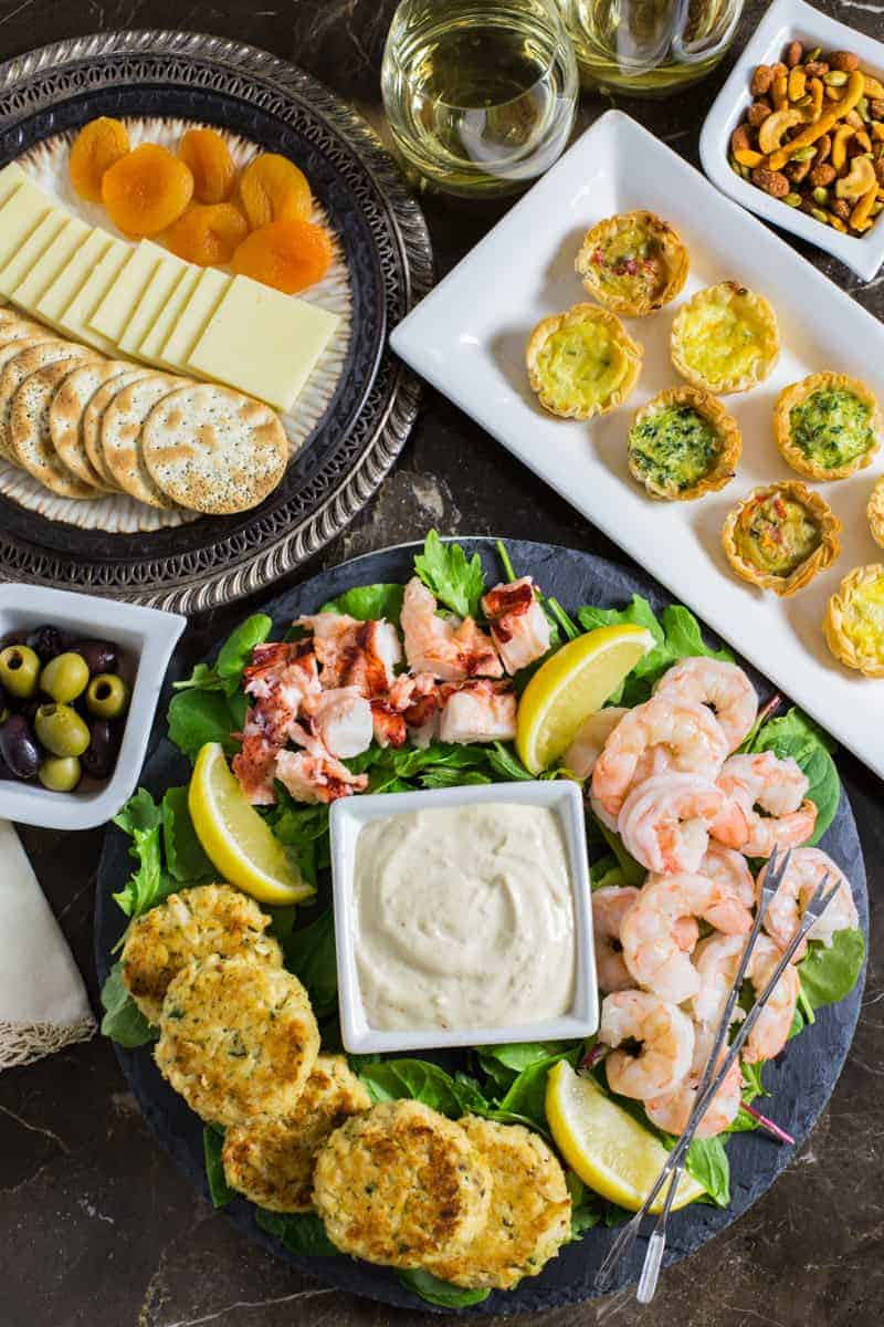 Seafood Appetizer Platter with Homemade Mustard Sauce on table with other appetizers