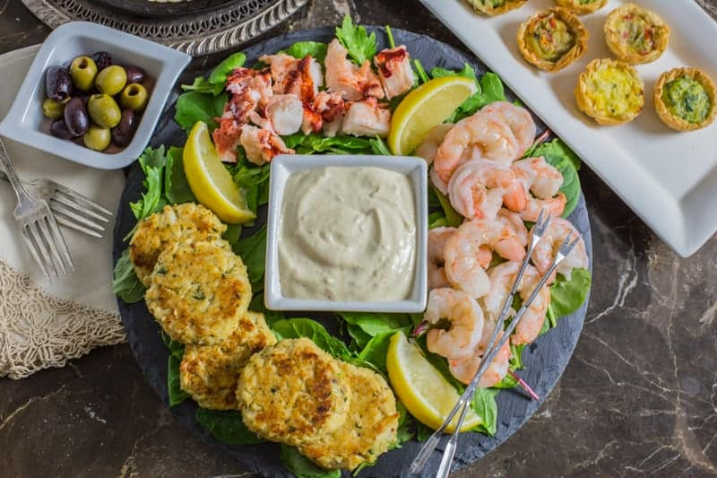 Close up photo of Seafood Appetizer Platter with Homemade Mustard Sauce on table