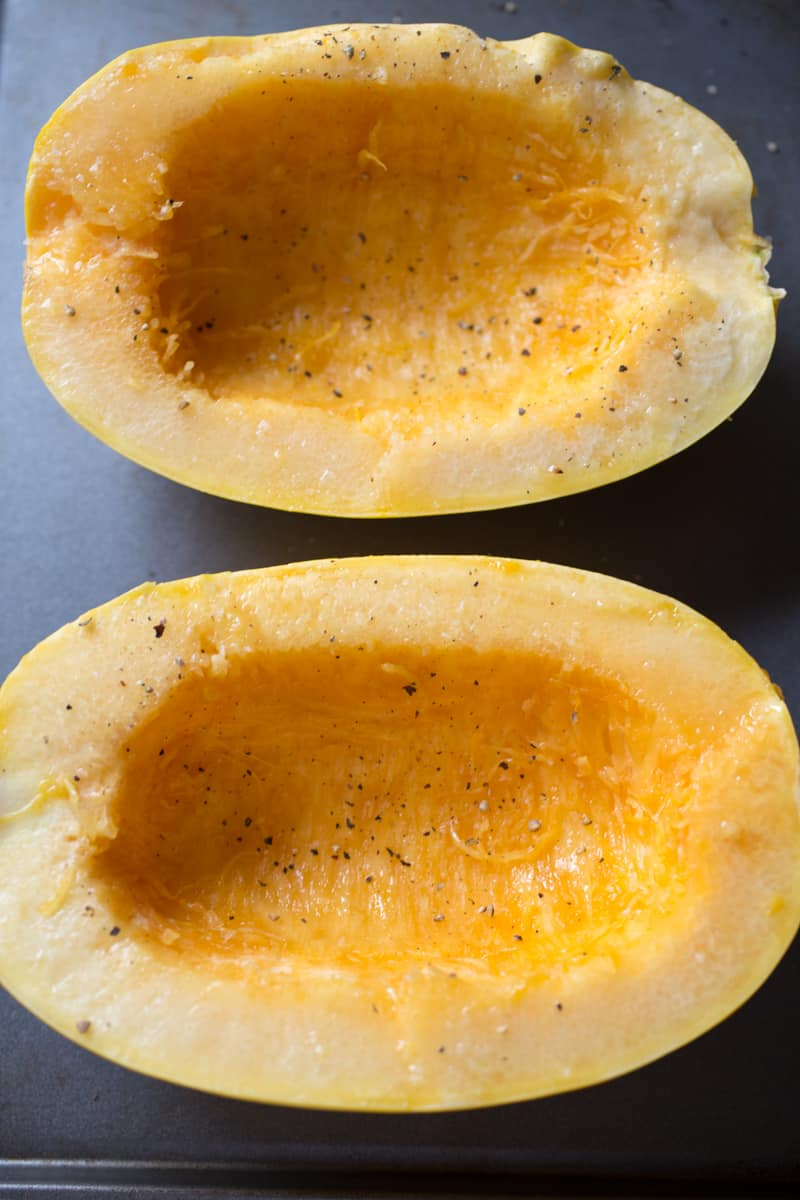 Spaghetti Squash halves on baking sheet