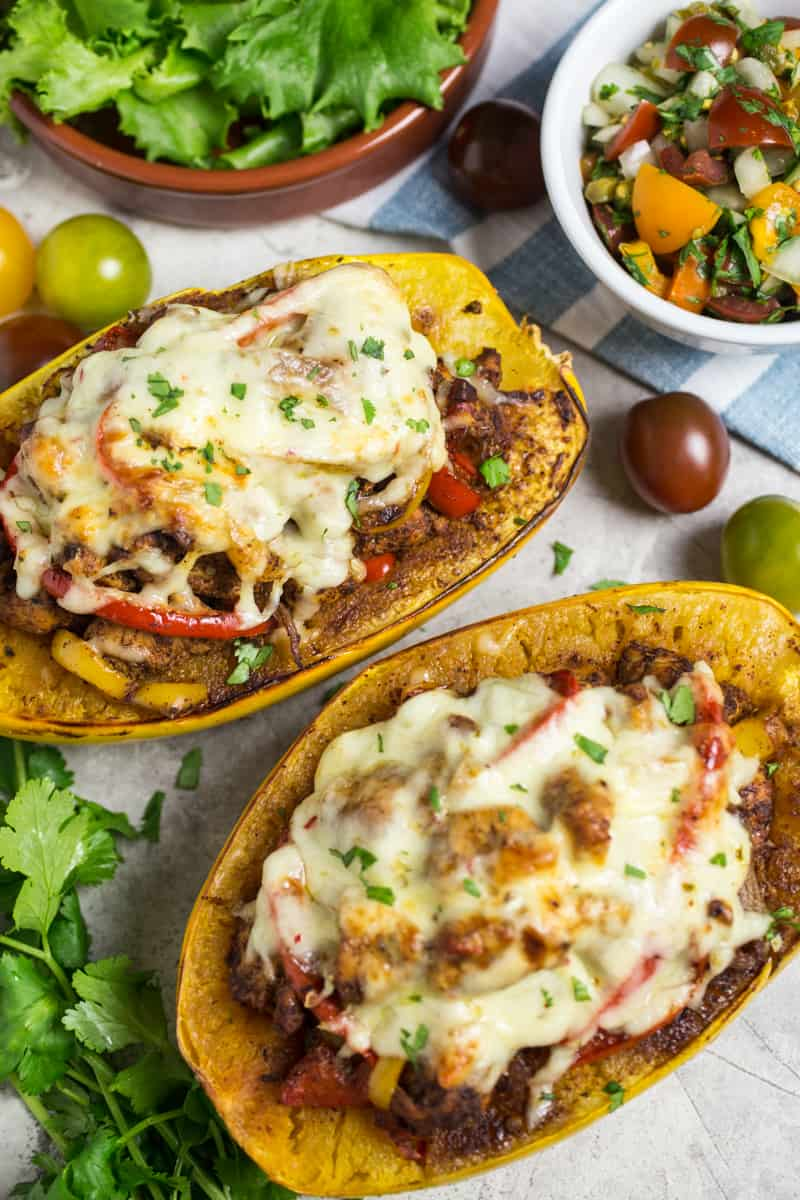 Chicken Fajita Stuffed Spaghetti Squash halves on table