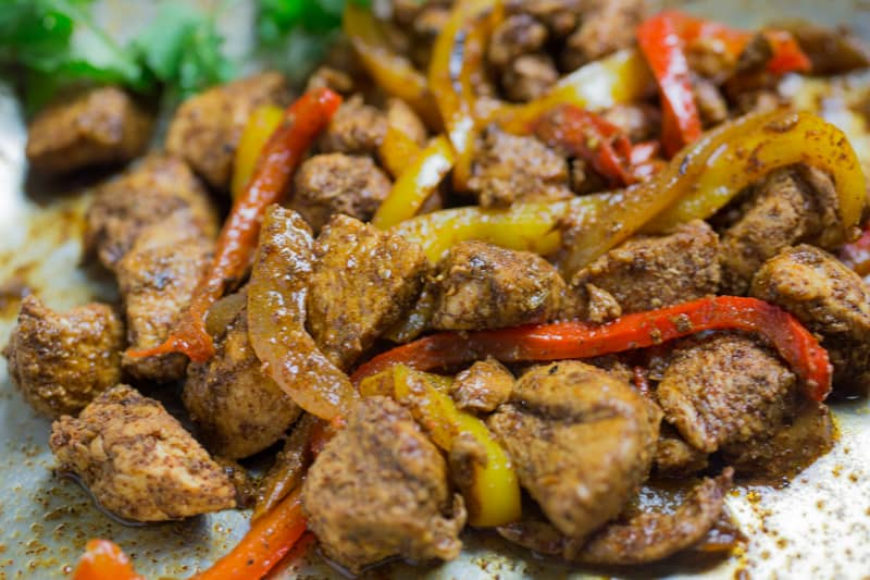 close up photo of cooked fajita chicken with bell peppers and onions