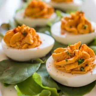 Deviled eggs on lettuce leaves