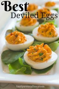 Close up of Best Deviled Eggs on lettuce lined plate