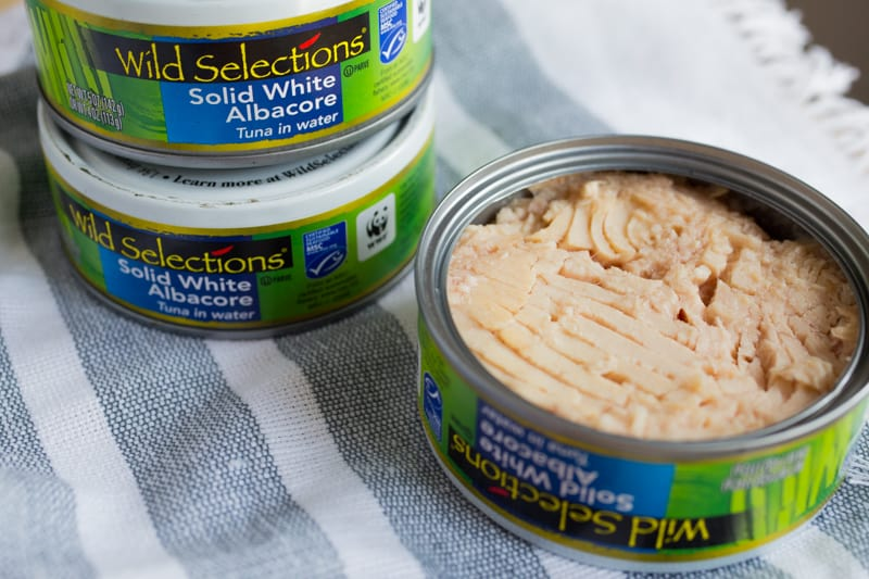Cans of Wild Selection Tuna with one can open showing tuna