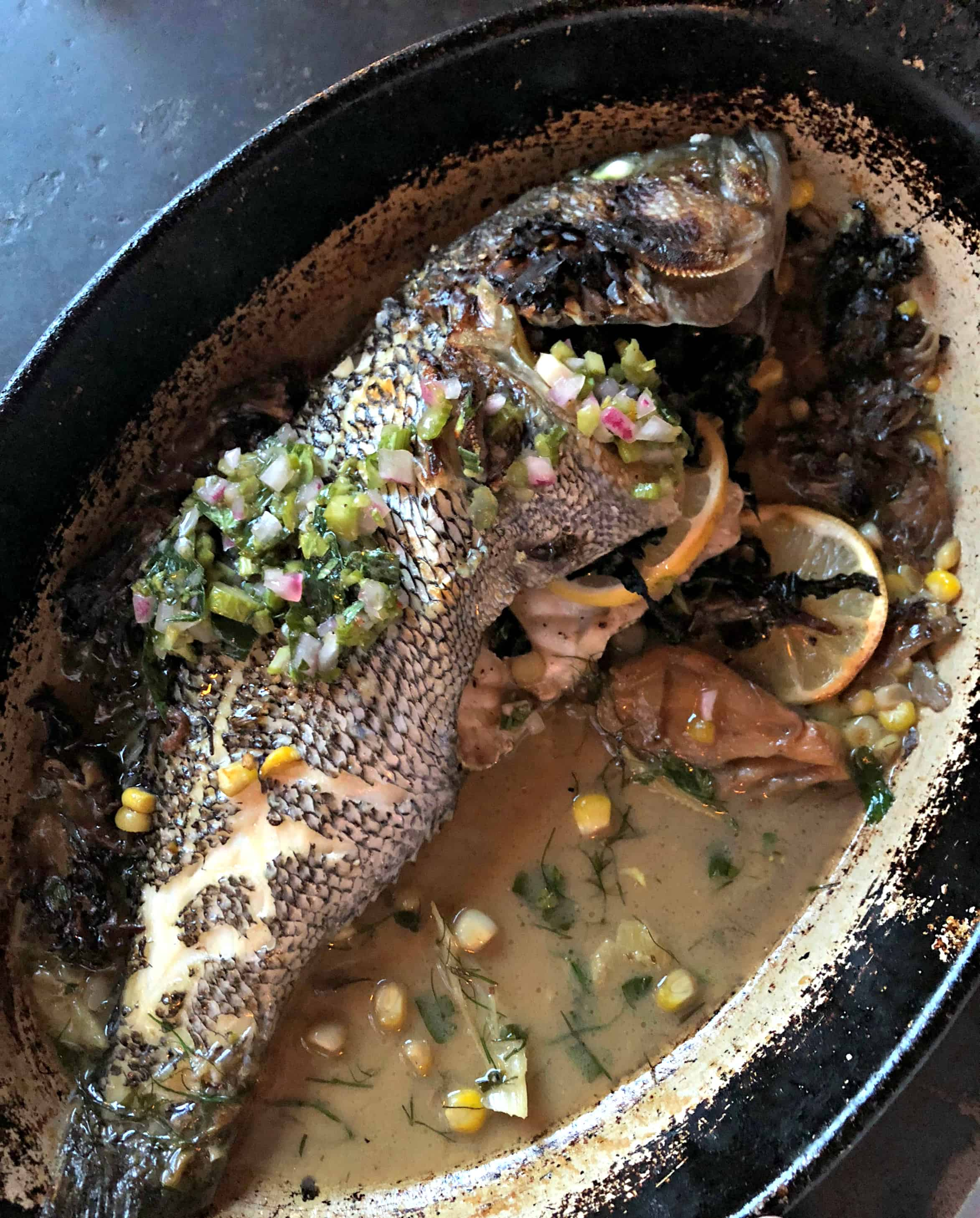 Sea bass in a cast iorn pan of best Things to do in Portland Maine