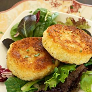 Risotto cakes on a salad