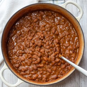 A pot of stovetop easy baked beans with a serving spoon in the beans